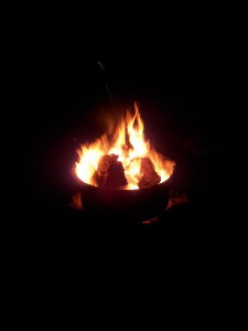 Sitting by Fire Ring at night
